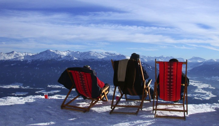 Three sunchairs looking into snowland
